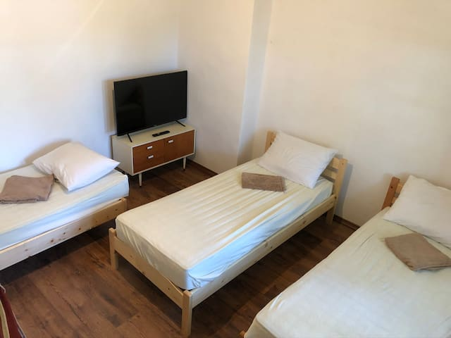 Clean and comfy room with three singles