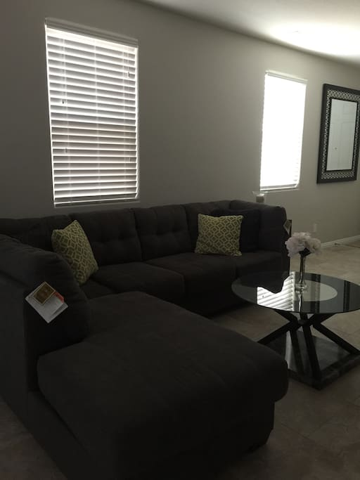 Cozy contemporary living area with 60 inch TV. Enjoy 200 Channels, and premium channels.