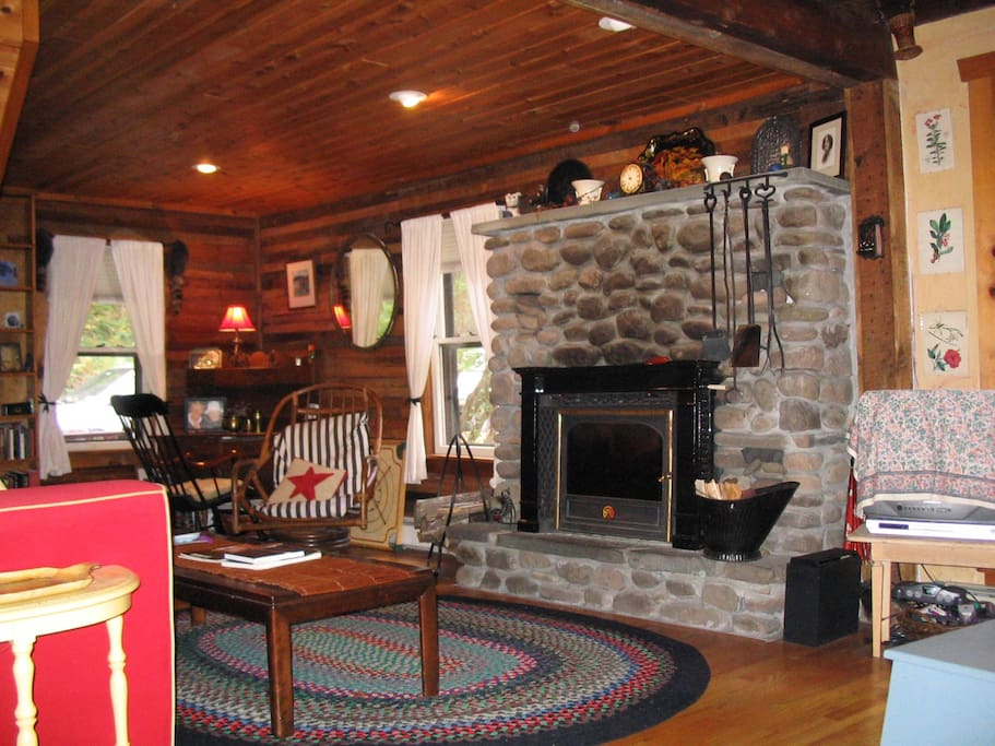 Living Room with great wood stove insert in the stone fireplace