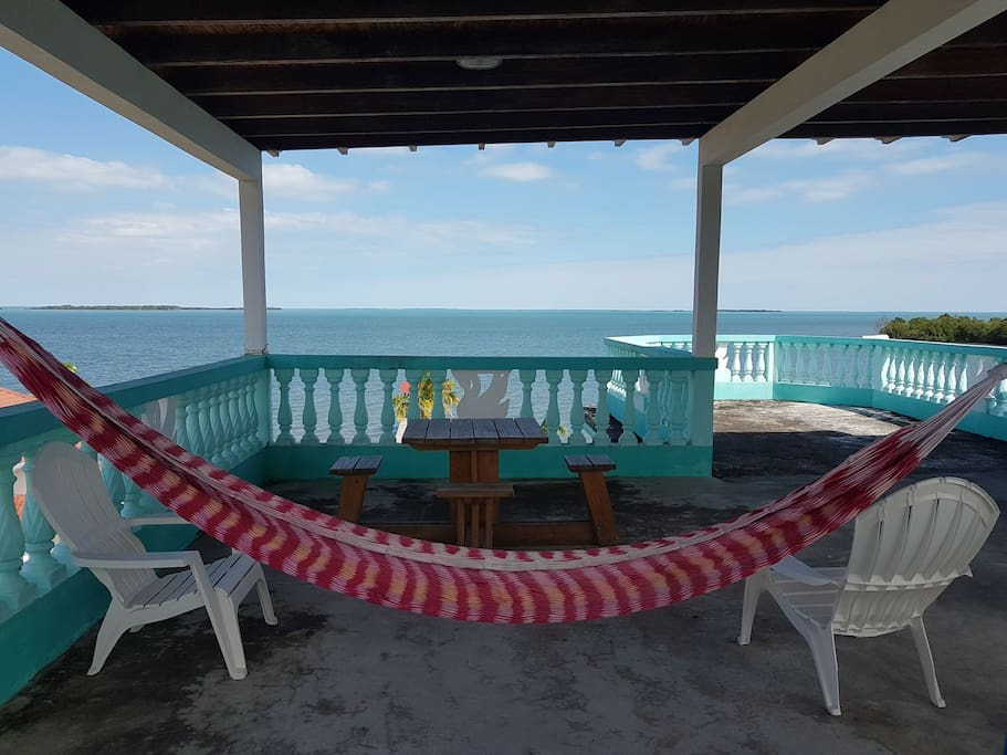 Relax on a hammock and enjoy the breathtaking view and cool breeze from the Caribbean Sea from the Roof Terrace