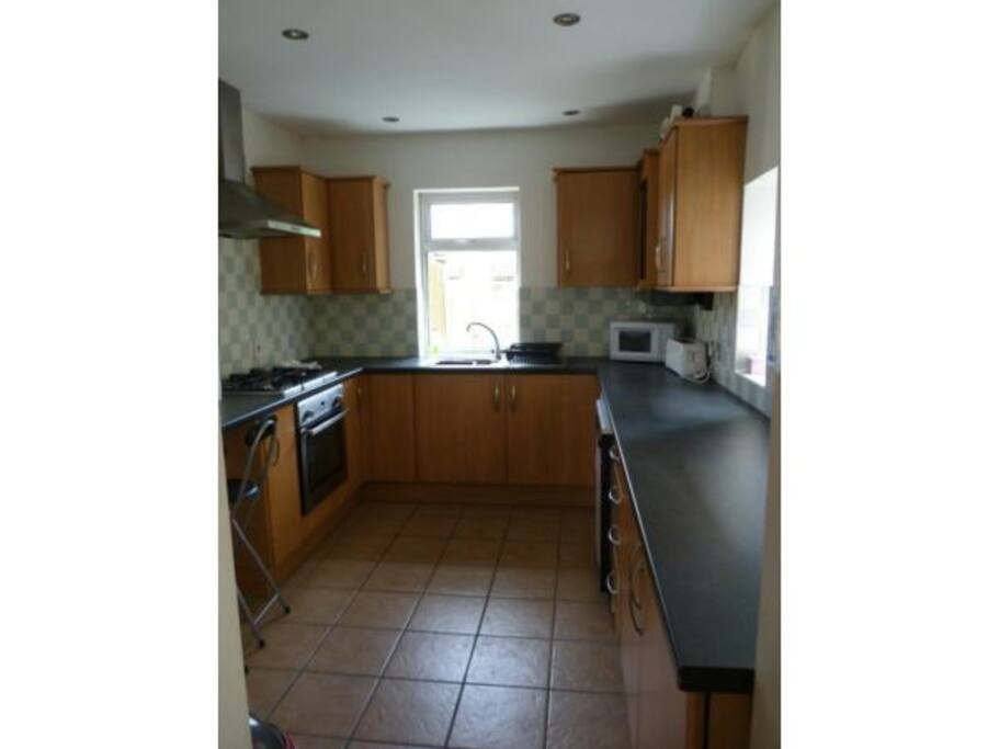 Fitted kitchen with extra freezer, washer and dish washer