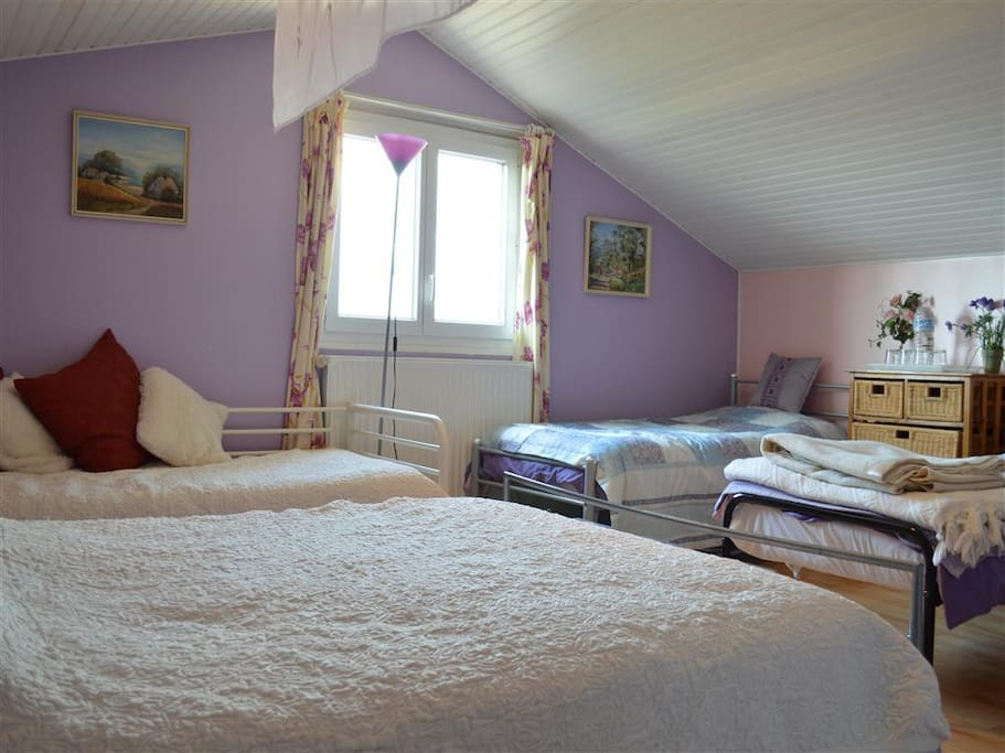 The Lavender room with 1 double and 3 single beds