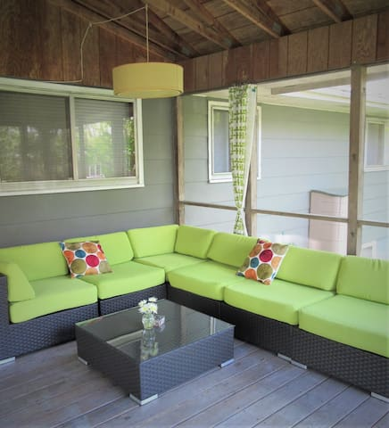 Porch lounge seating in private, fenced yard with. Cathedral ceiling, fan, lighting. Bird watching at its best!