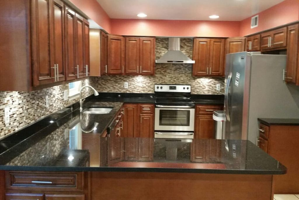 Sparkling granite countertops and stainless steel appliances