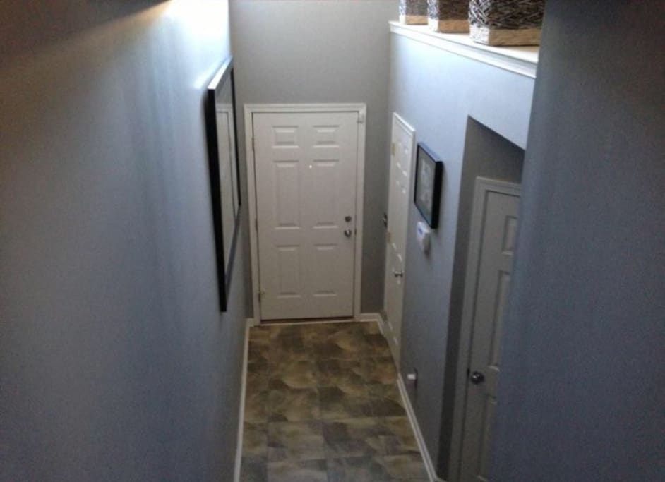 Enter through a cathedral ceiling foyer with hardwood floors.