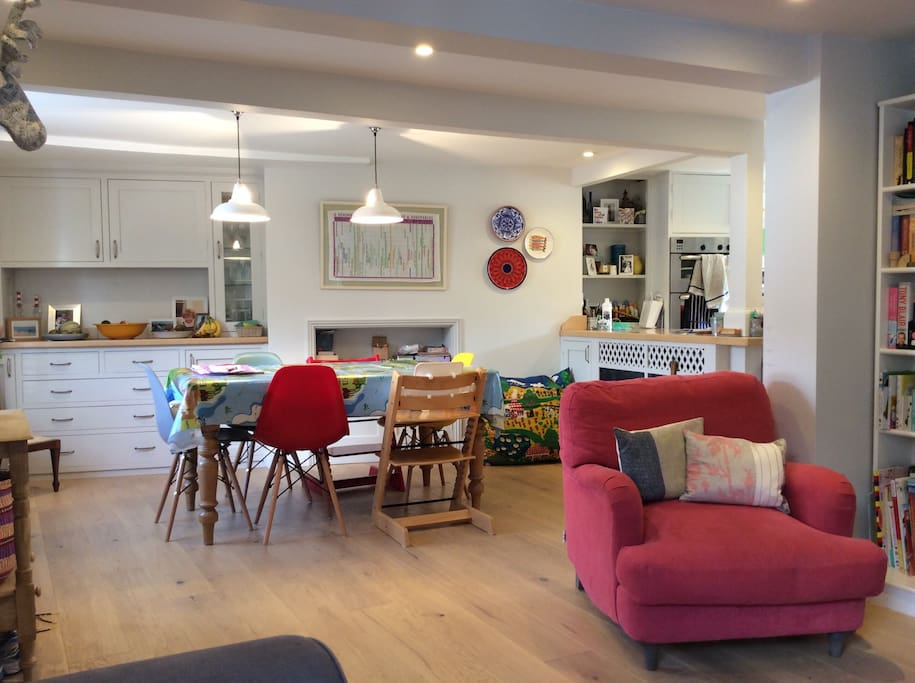 Open plan kitchen/eating area with cosy sitting area