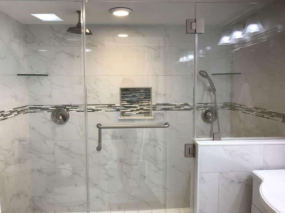 Master bathroom w/ rain shower and sitting area