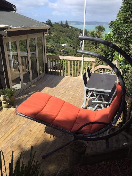 Top deck with swing chair