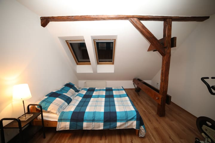 Lower floor master bedroom with king size bed and a spacious built-in wardrobe.