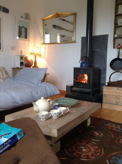 Relax on the day bed next to a wood burning stove :)