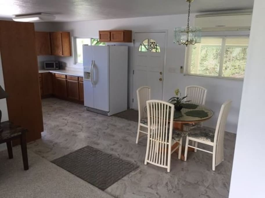 Newly renovated kitchen, full sized refrigerator, microwave, 4-seat dining table