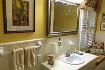 The hall bathroom has plenty of room and the cutest little window seat!