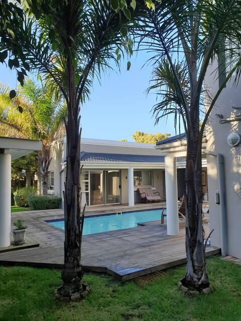 Luxurious Bauhaus style flat in tropical garden.