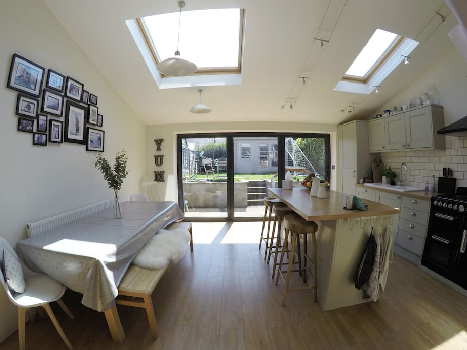 Spacious open plan kitchen with bi-fold doors opening onto the garden