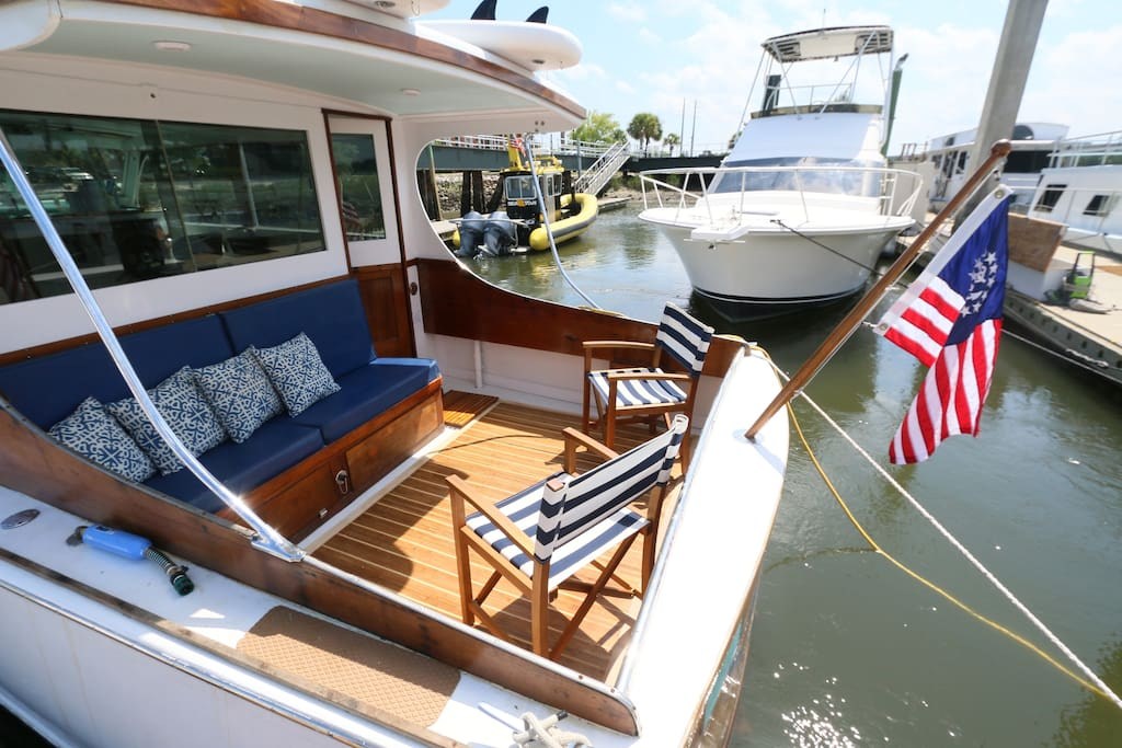 Enjoy coffee or a cocktail on the aft deck. Blue LEDs shine down on her at night.