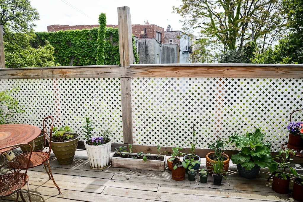 Sunny, quiet, plant-filled outdoor deck