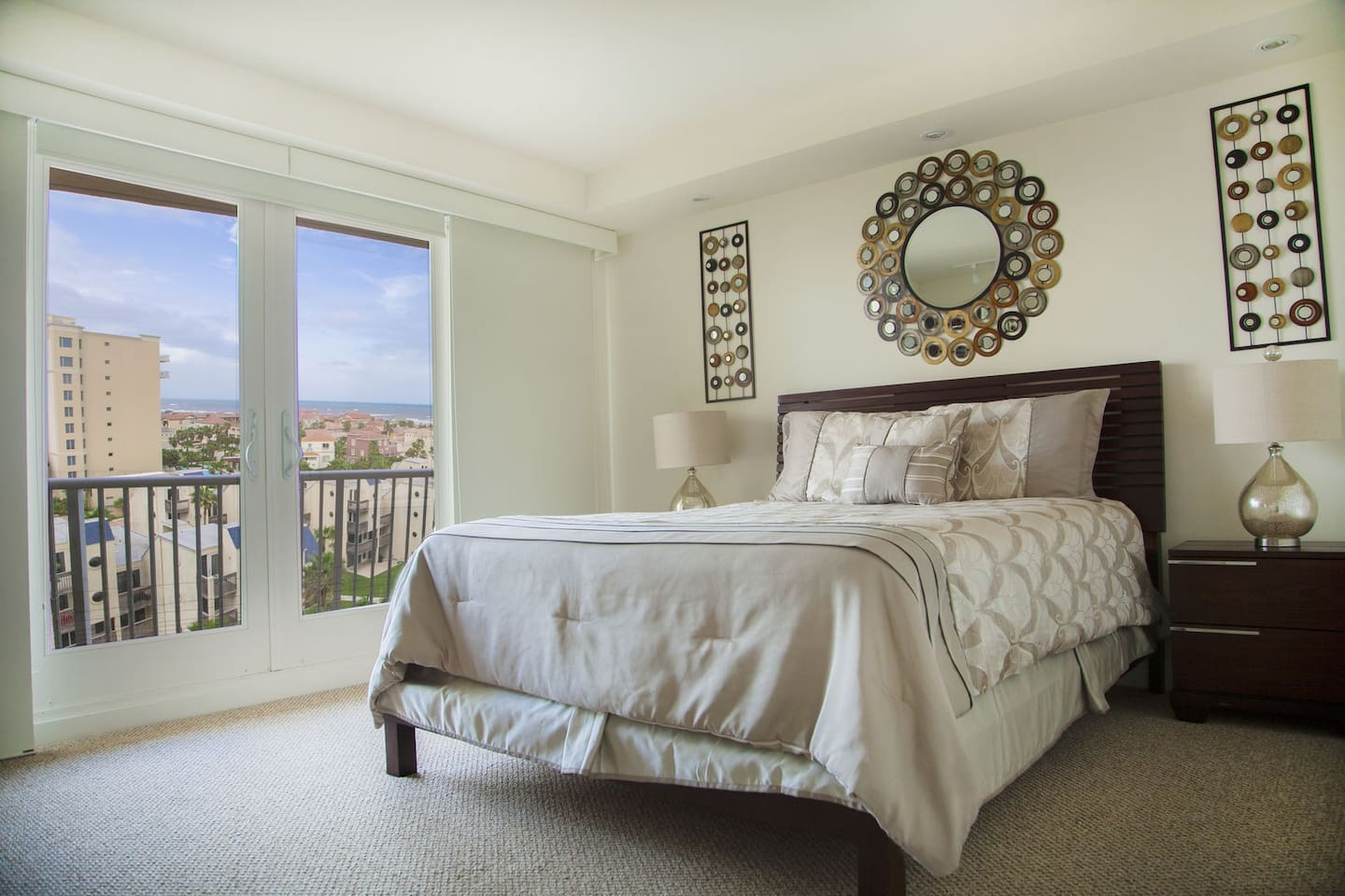 Master Bedroom offers King size bed and great view of the pool area and a partial view of the ocean.