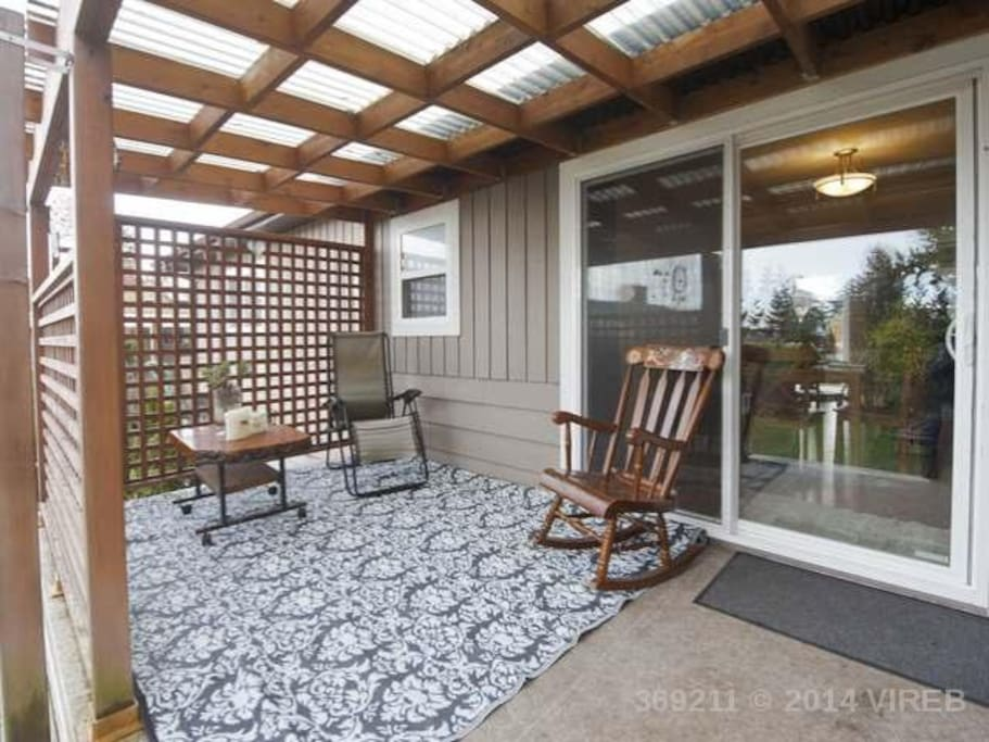 Covered backyard patio off of dining room
