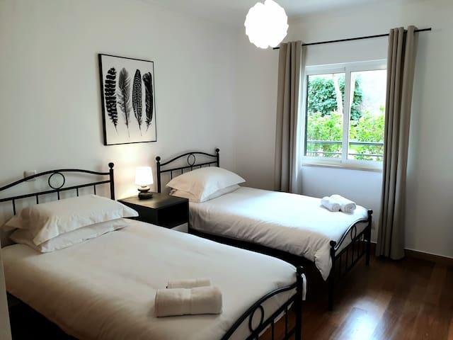 Guest bedroom, with garden view.