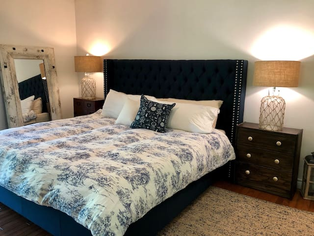Master bedroom with king bed and memory foam mattress.