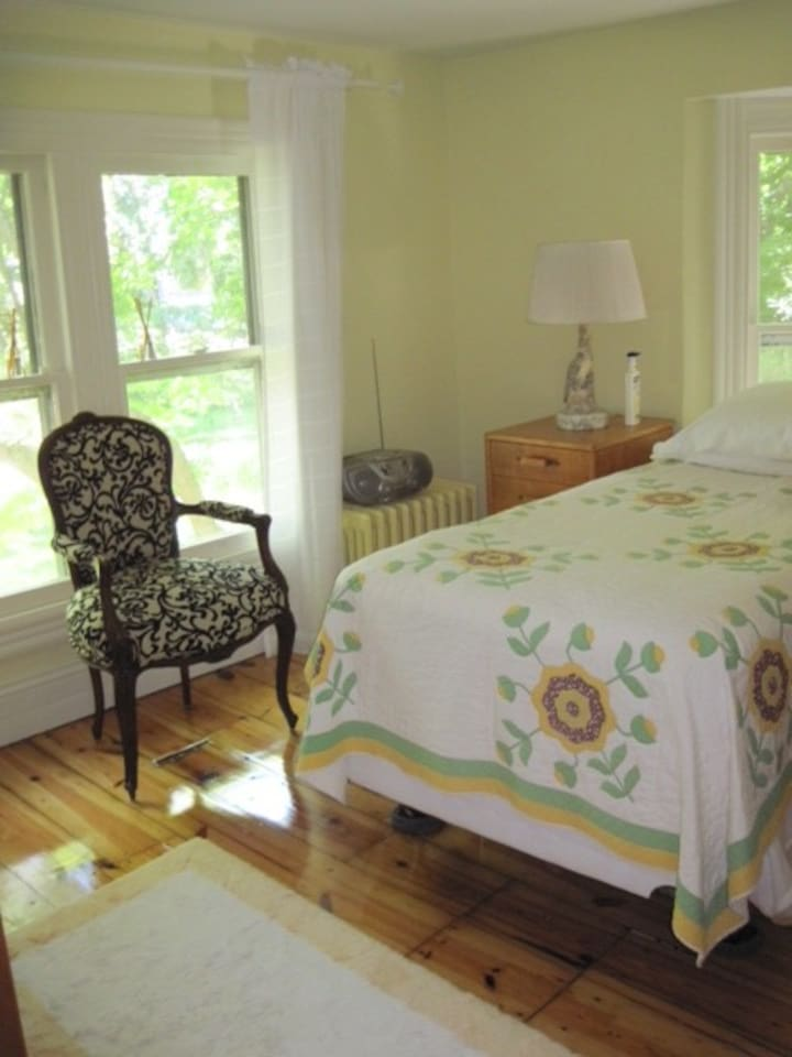 bright bedroom with a Full size bed and private attached bathroom.
