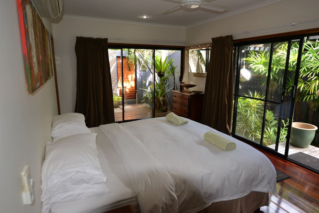 Master bedroom with outside and inside ensuite, walk in robe and TV.