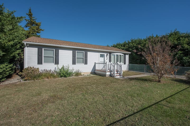 Front exterior with driveway parking and street parking and full fenced in yard.