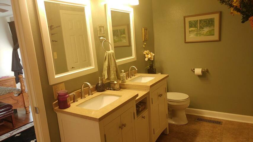 Roomy bath attached to queen & double bedrooms in muted shades of sage