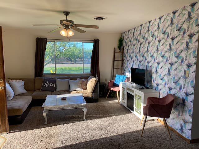 Large open living room with orchard views