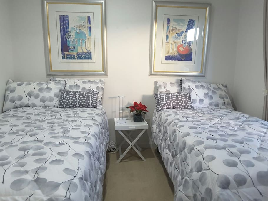 Bedroom set up with two single beds