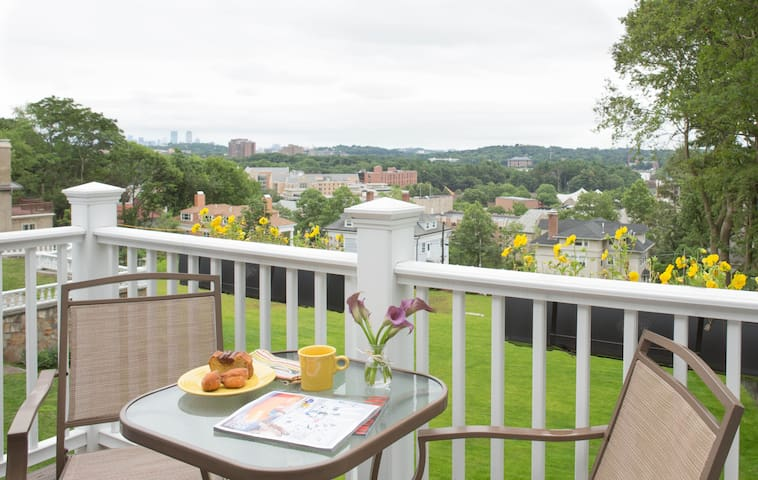 Deck with panoramic views of Boston skyline and BC