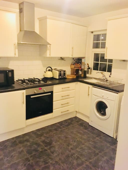 Kitchen with fridge freezer, tumble dryer, washing machine and oven