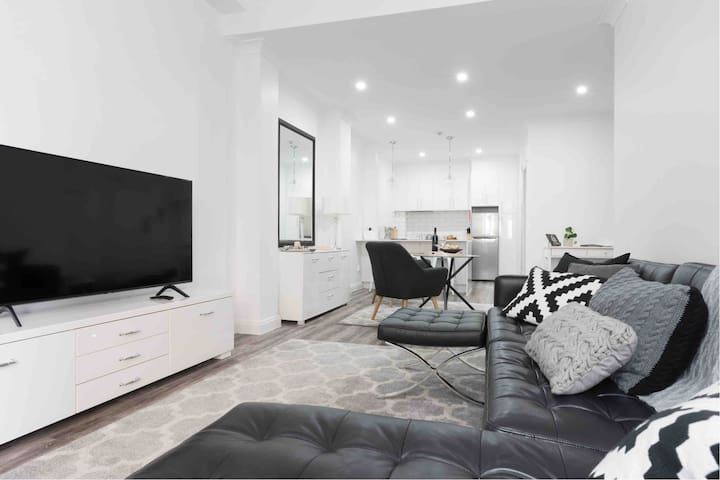 """View from bay window towards kitchen spacious open plan living, dining and kitchen.  55"""" Samsung Smart TV.  90Mbps speed Wifi."""