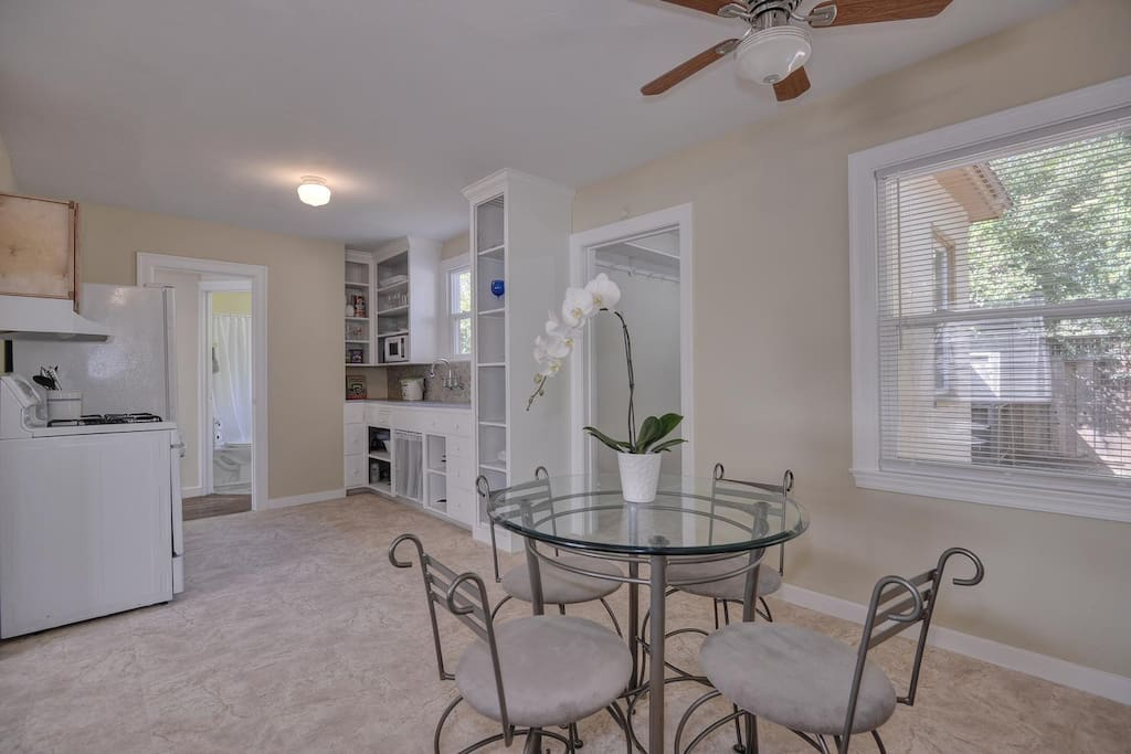 Dining area and kitchen are incredibly spacious and feature light-filled large bay windows.