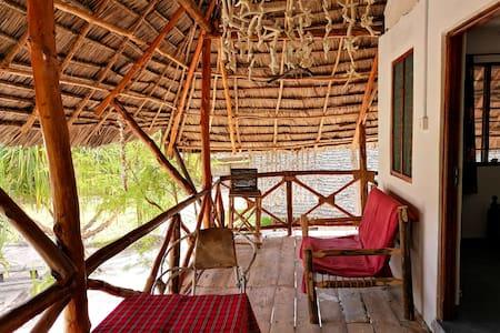 Minazini- Bantu House -lovely room,cozy veranda