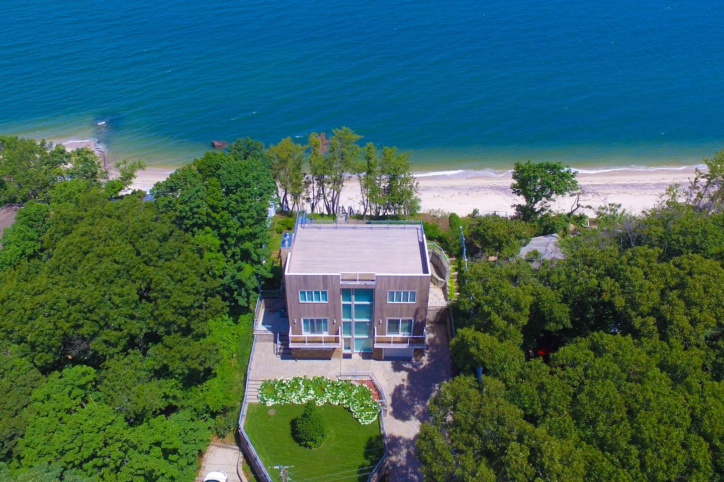 Bird eye view of our waterfront beach home with Private Beach access