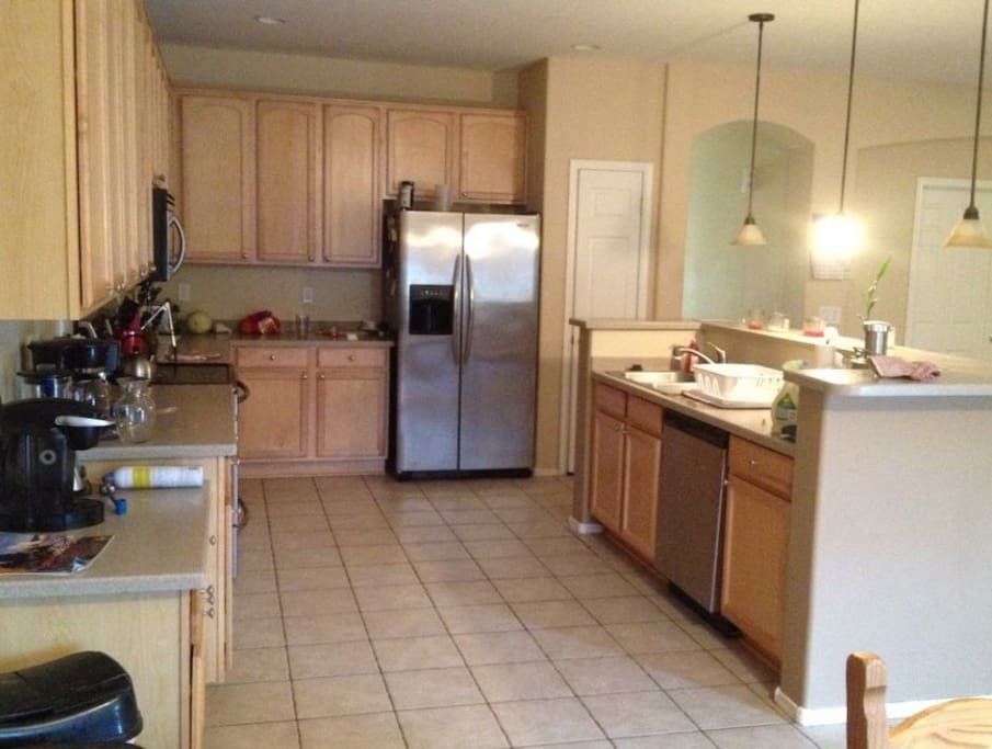 Kitchen has two refrigerators for plenty of space