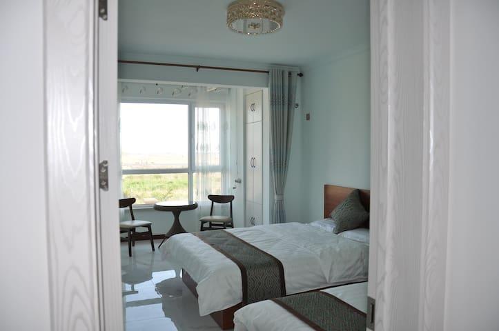 卧3:海景家庭房