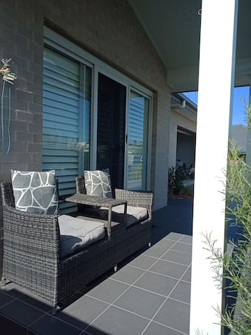 Relax and enjoy a glass of wine or coffee on your private sunny porch.