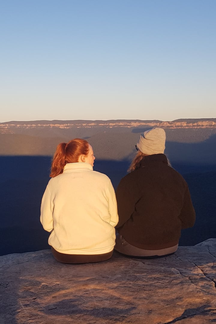 Sitting on rock seat near edge
