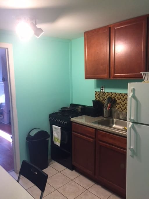 Kitchen: Includes stove, oven, fridge, sink, toaster and water boiler.