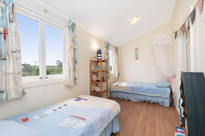 The second bedroom is fitted with two comfortable single beds. This room is perfect for those travelling with children.