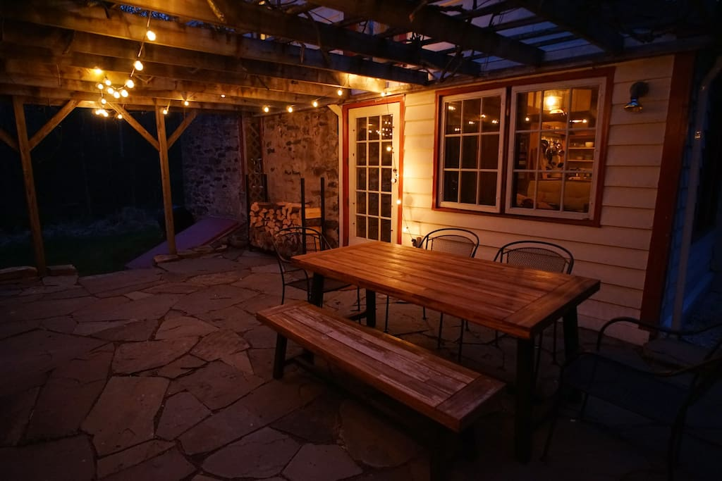 The patio at night. A table for six is ready for all of your al fresco meals.