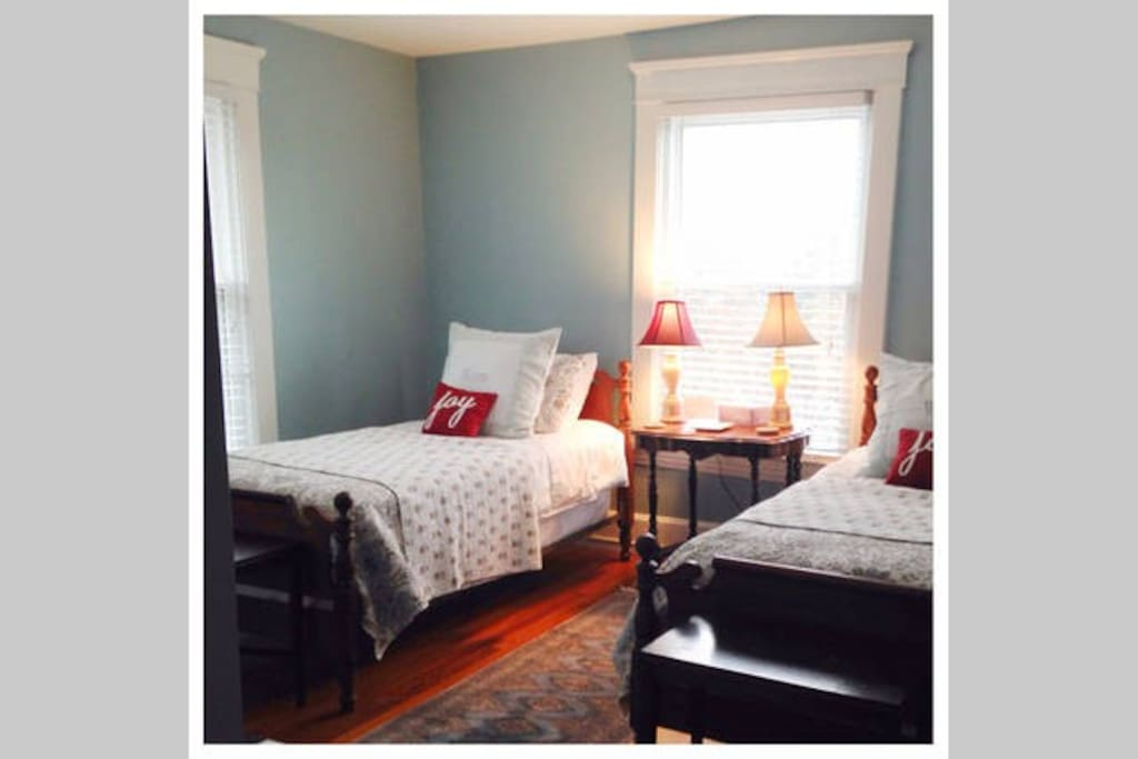 Room 1 has two single beds, closet, reading chair and lots of natural light.