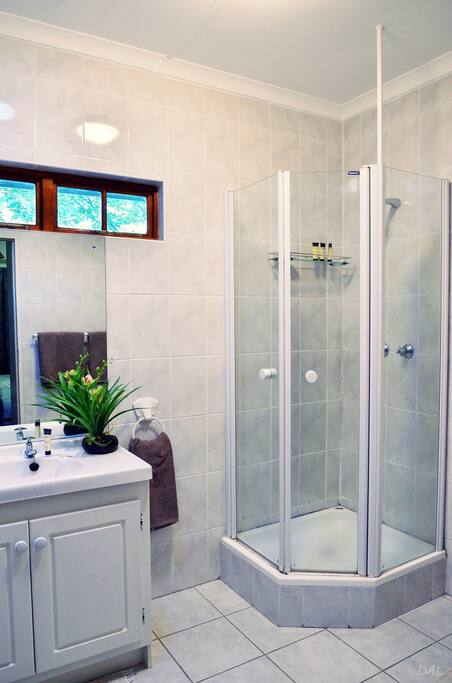 Clean bathrooms with basic toiletries, mosquito repellant and bath sheets provided