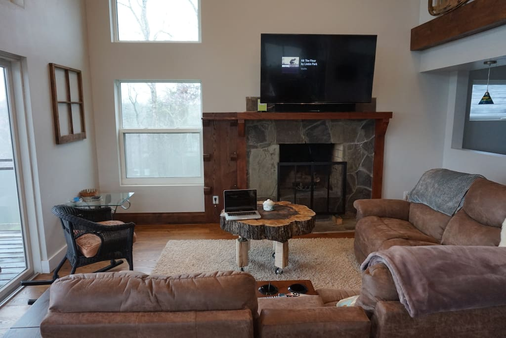 Living room with 65 inch TV, Apple TV & Maple Trunk coffee table (with wheels)