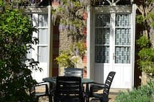 You can eat outside in the gite garden when the weather's good!