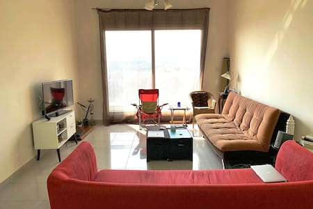 Living room with queen size sofa bed with balcony