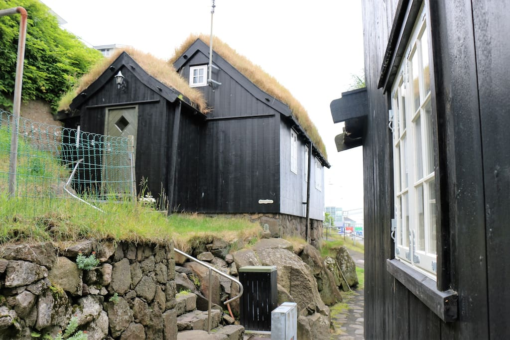 The grass roofed traditional Faroese house is built on a rock.