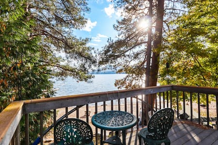 Lakefront getaway w/ wood stove, deck, and kayaks - up to two dogs welcome!